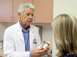 Image of doctor consulting patient on medication