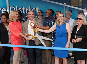 Image of the ribbon cutting on the new mobile health clinic