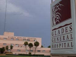 The sign for Glades General Hospital. The hospital can be seen in the background.