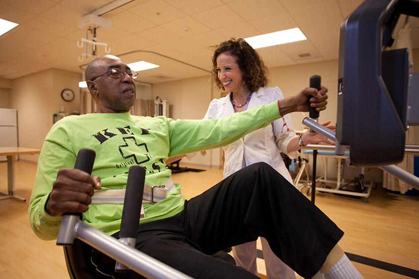 Healey Center resident performing rehabilitation exercises