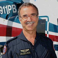 A photo of Gerald M Pagano standing in front of the Trauma Hawk