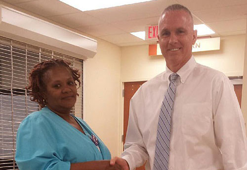 Carolyn Holmes shaking the hand of Rick Roche
