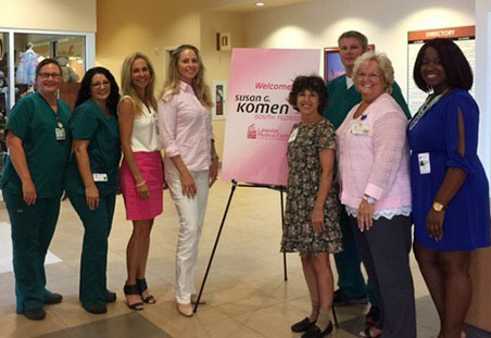 Group photo of Lakeside staff standing around a sign that reads Welcome Susan G Komen
