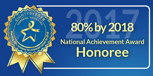 Ribbon with text to the right that reads 80 percent by 2018. National Achievement Award Honoree