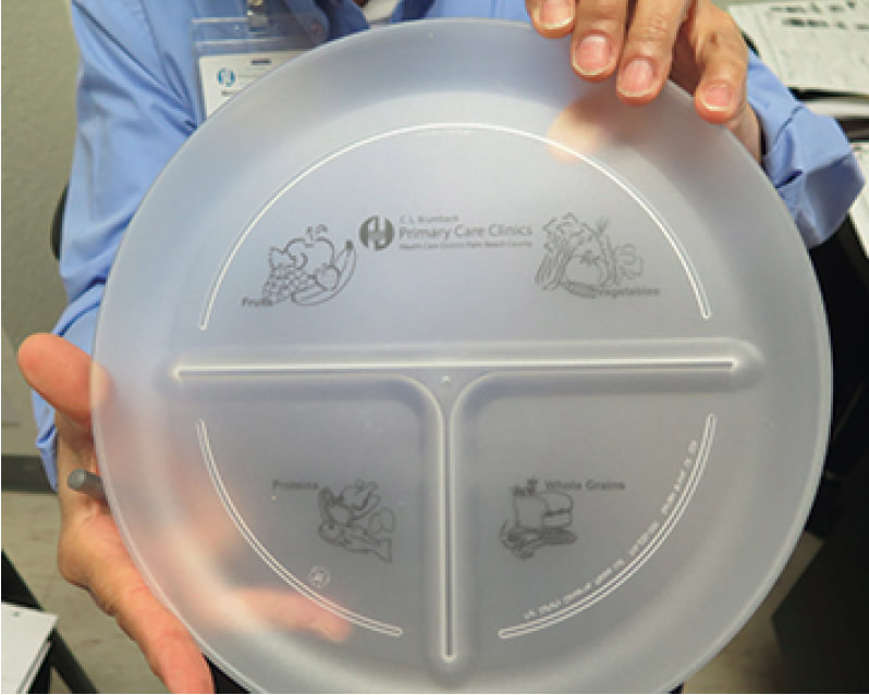 A plate with dividers for the right portion size of fruit, veggies, proteins and grains