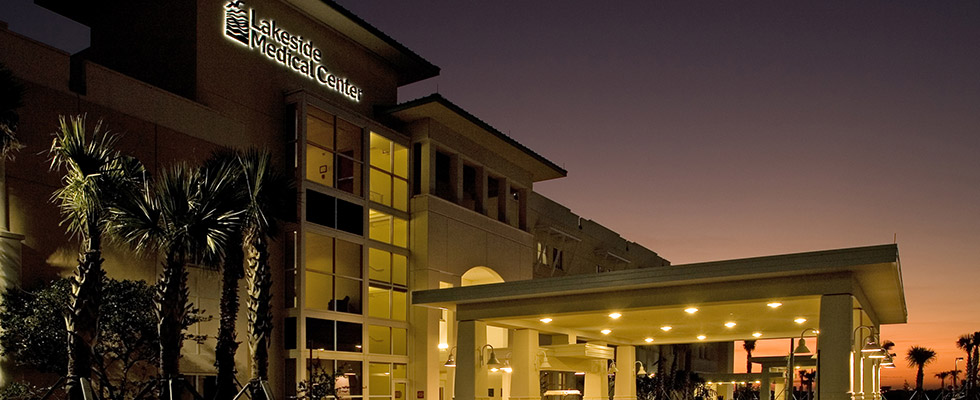 The front of the Lakeside Medical Center building at night