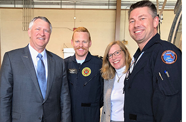 Darcy Davis with David Barbe and two members of the Trauma Hawk flight team.