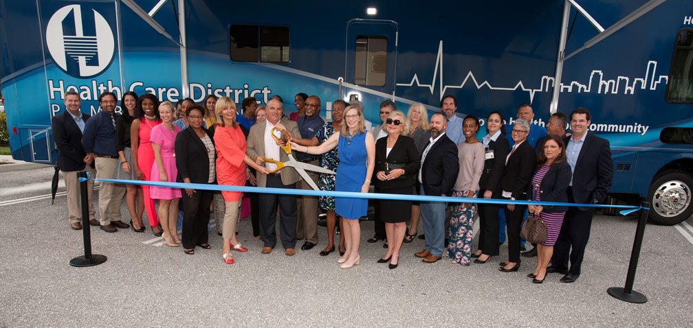 Image of Health Care District Staff and Partners Cutting the Ribbon