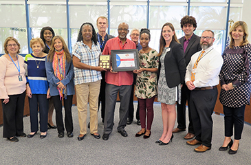 Image of the C. L. Brumback Clinic Staff Receiving Recognition from AHA