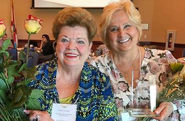 Image of Sandra Chamblee and Terri Calsetta with Awards