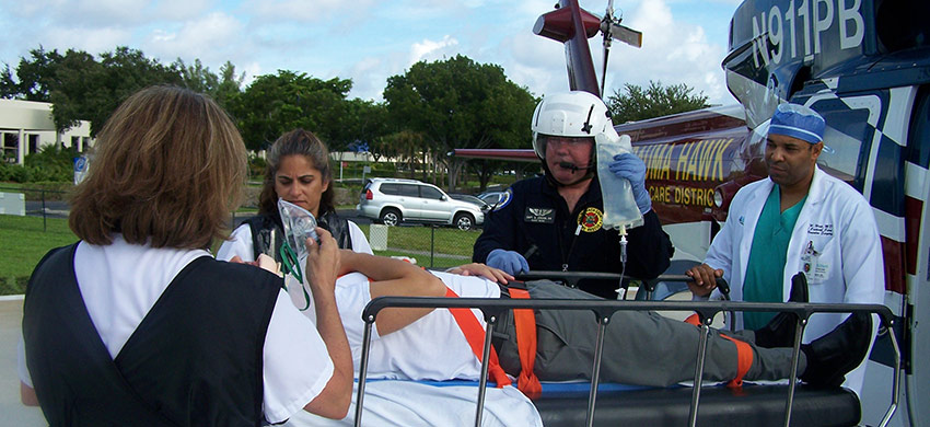 A patient being wheeled out of the Trauma Hawk on a gurney